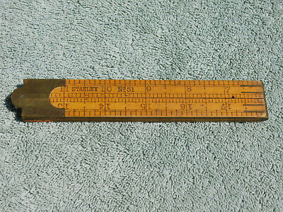 Vintage Stanley wood folding ruler number 68 A Unfolds to 24 made in USA Wood and brass.