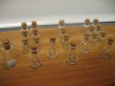 20 + 1 clear bottles with cork stoppers. 20 eye-hooks as extras. Art vials.