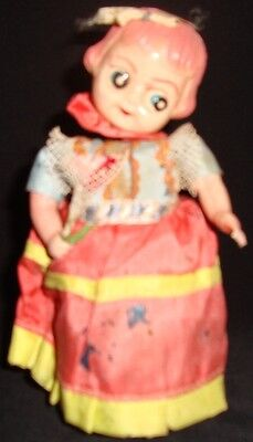 . Old Vintage Winding Tin + Celluloid Doll with Flower from Japan 1930