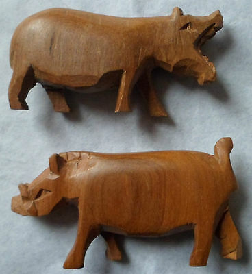 Wood figures hand carved African warthog and  hippo