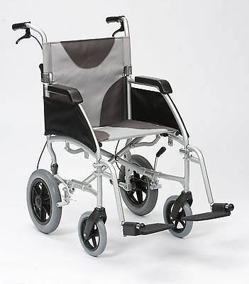 "Ultra Lightweight aluminium folding transit wheelchair with extra wide 20"" seat"