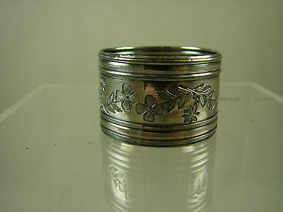 Delightful silver plate napkin ring with floral motif and banded rims