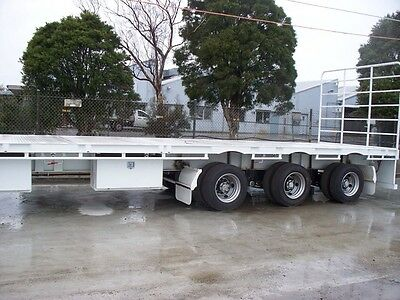 extendable flat top tri axle trailer
