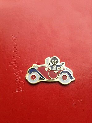 GENUINE ROBERTSONS 1980's GOLLY BADGE IN A RED CAR WHITE TYRES ,BUMPERS & DOORS