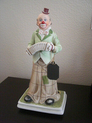 MELODY IN MOTION-CLOWN PLAYING ACCORDIAN, HAND PAINTED-BISQUE PORCELAIN