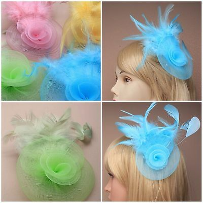 Net Rosette Fascinator With Feather Detail On A Clip And Brooch Pin