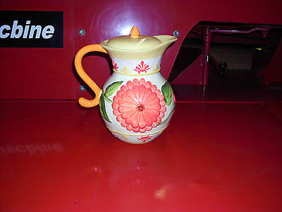 VINTAGE HEAVY LARGE CERAMIC/POTTERY ORANGE/ YELLOW PITCHER WITH FLOWERS