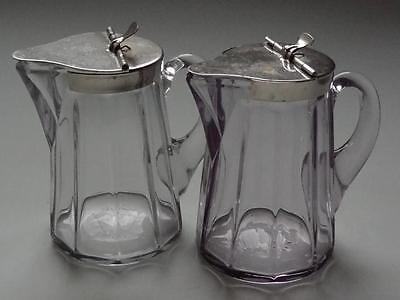 LOT OF 2 ANTIQUE HEISY PRESS GLASS SYRUP JARS METAL SPRING LOADED CHROME LID
