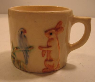WELLER POTTERY, CHILDS CUP,PARROT AND HAIR/RABBIT,RAISED,ORIGINAL HAND SIGNED