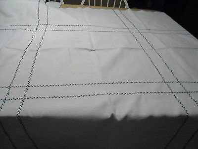 Vintage white cotton tablecloth with green stitching and hem