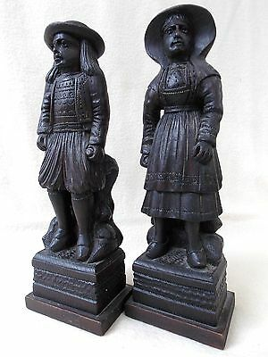 TWO OLD CARVED WOOD FIGURES. MERCHANT AND WIFE.