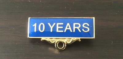10 YEARS Pin. Service Award Badge With Blue Background.