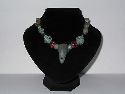 Ancient necklace with an amulet in the form of Tusk