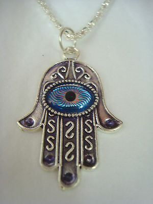 "Pretty Silver look metal ethnic necklace with""hand of fatima""eye pendant detail."