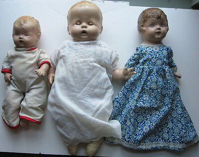 Lot of three antique composition and bisque dolls with clothes