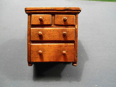 A ANTIQUE WOODEN DOLL CHEST OF DRAWS APPRENTICE ITEM