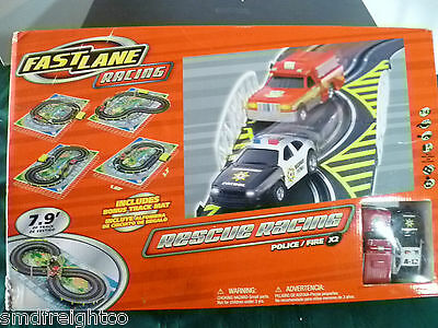 FAST LANE RESCUE RACING SLOT CARS SET 1:43 SCALE POLICE CAR & FIRE TRUCK