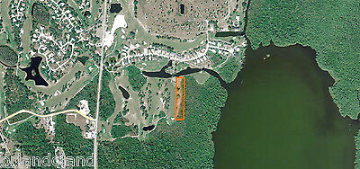 Nice 2.4 acre lot 750' Golf Course frontage + canal front 3700 acre Lake Pierce