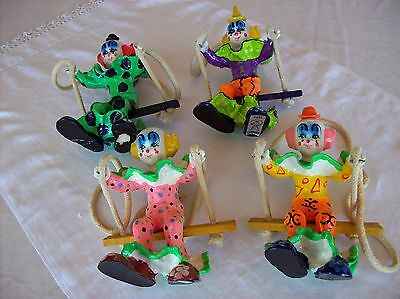 COLLECTIBLE RAUL CARMONA HAND PAINTED SWINGING CLOWNS - SET OF 4