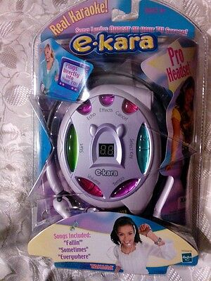 New e-kara karoake system bundle w/ 2 pro headsets, 4 karaoke cartridges