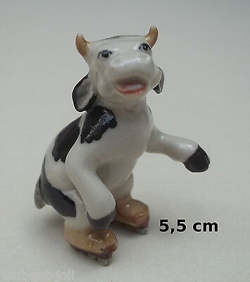vache en porcelaine ,miniature de collection,koe, kow,patin à glace, B2-03