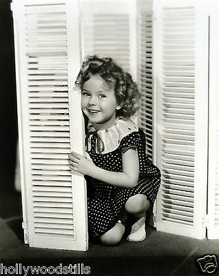 Shirley Temple kneels behind shutters 8x10 rare photo