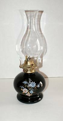 BLACK BASE WITH WHITE FLOWERS AND CLEAR CHIMNEY OIL LAMP