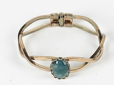 Vintage bracelet green cabochon stone costume gold tone twist hinged estate