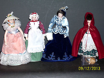 COLLECTION OF 4 AVON 1985 PORCELAIN DOLLS WITH STANDS