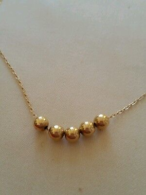 14k beaded necklace.Solid gold. Nice buy. 1.3 grams. 16 inches