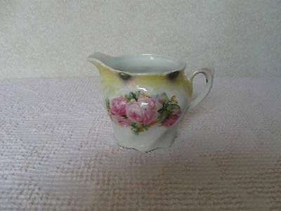 Vintage Porcelain Creamer marked Germany with a crown Pink Rose yellow on white
