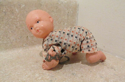 S38 vintage celluoid wind up creeping baby doll