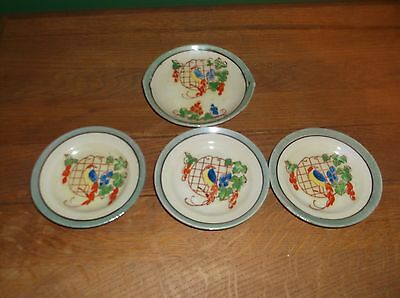 A 4 Piece Small Hand painted Saucer Set Stamped made in Japan