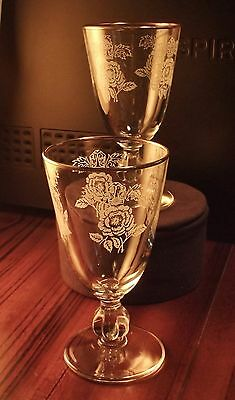 """TWO 1950's Libbey wine glasses.Pattern """"White rose and crown""""Gold trim.Stem 3003"""