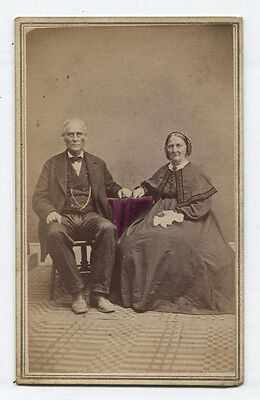 Cdv Older Couple Seated Pose. Carpet In Foreground Of Photo. Tinted. Eaton, Ohio