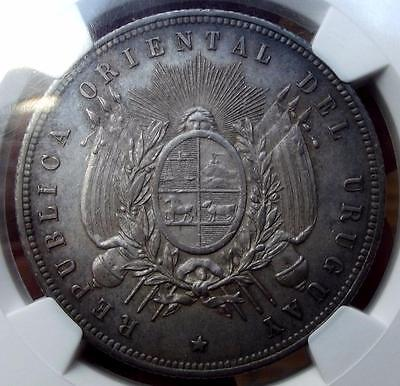 1877 URUGUAY 1 PESO - KM # 17 - slabbed by NGC AU 58 - BLUE TONED SILVER COIN