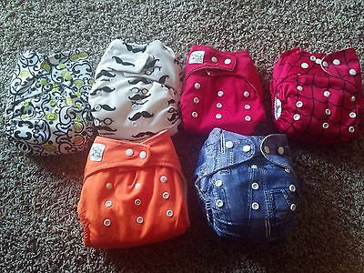 6 all size premium cloth diapers with three wet bags!