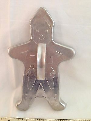 Vintage aluminum cowboy christmas cookie cutter Gingerbread man sheriff gun