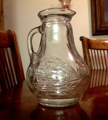 AntIque glass jug ship on glass.