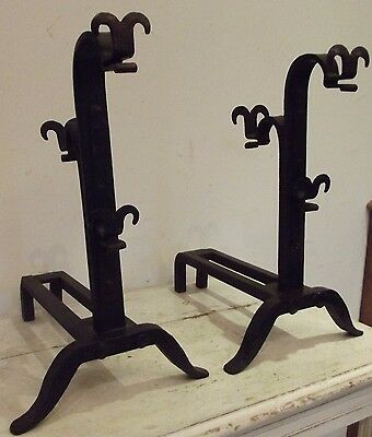 pair of andirons decorated with wrought iron fleur de lys antique french firepla