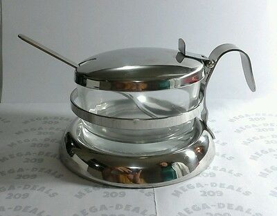 Stainless and glass sugar serving bowl with spoon