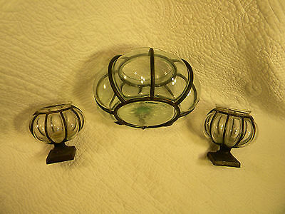 Set of 3 round glass and metal candle holders in excellent condition.