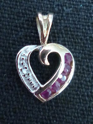 Used 9ct solid gold Ruby & Diamond set heart form pendent sweet