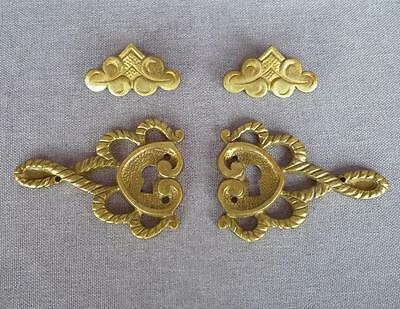 4 antique furniture ornaments and handles set made of brass France 1930's