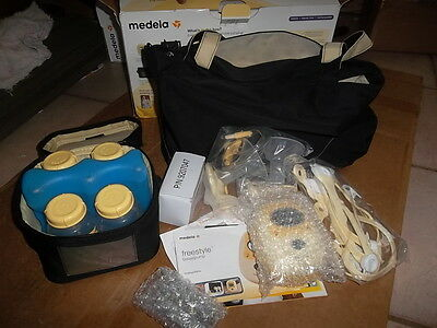 NEW-  MEDELA FREESTYLE BREAST PUMP - NEW OPENED BOX . Genuine