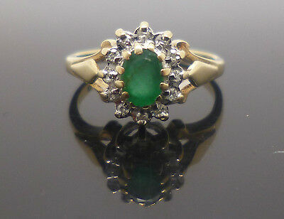9ct yellow gold emerald and diamond cluster ring with full British hallmark