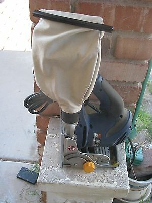 Blue Ryobi 6-Amp Biscuit Joiner JM82 and dust collector
