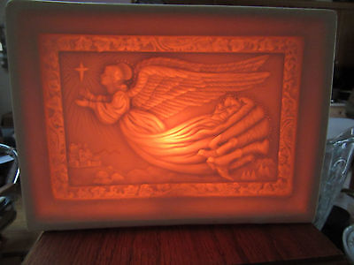 Porcelain table lamp with flying Angel