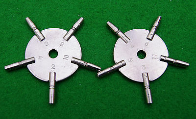A pair of spider/star winding key sizes 2,3,4,5,6,7,8,9,10,11