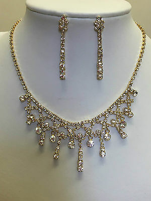 Bridal dangle necklace and earrings set in gold colour with crystal rhinestones